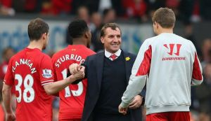 Rodgers celebrates with his players