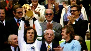 Beckenbauer lifts the 1974 FIFA World Cup Trophy