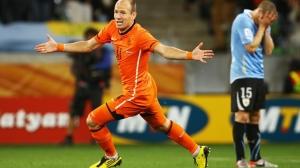 Robben wheels away in celebration during Le Oranje's semi-final win